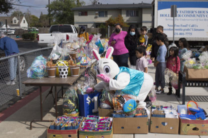 The Easter Bunny sorts through the baskets to find one that is age appropriate. Photo by Noe Magaña.