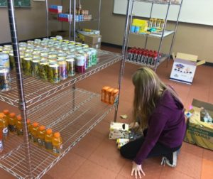 A student stocks the San Benito High School pantry. Photo courtesy of Jim Lewis.