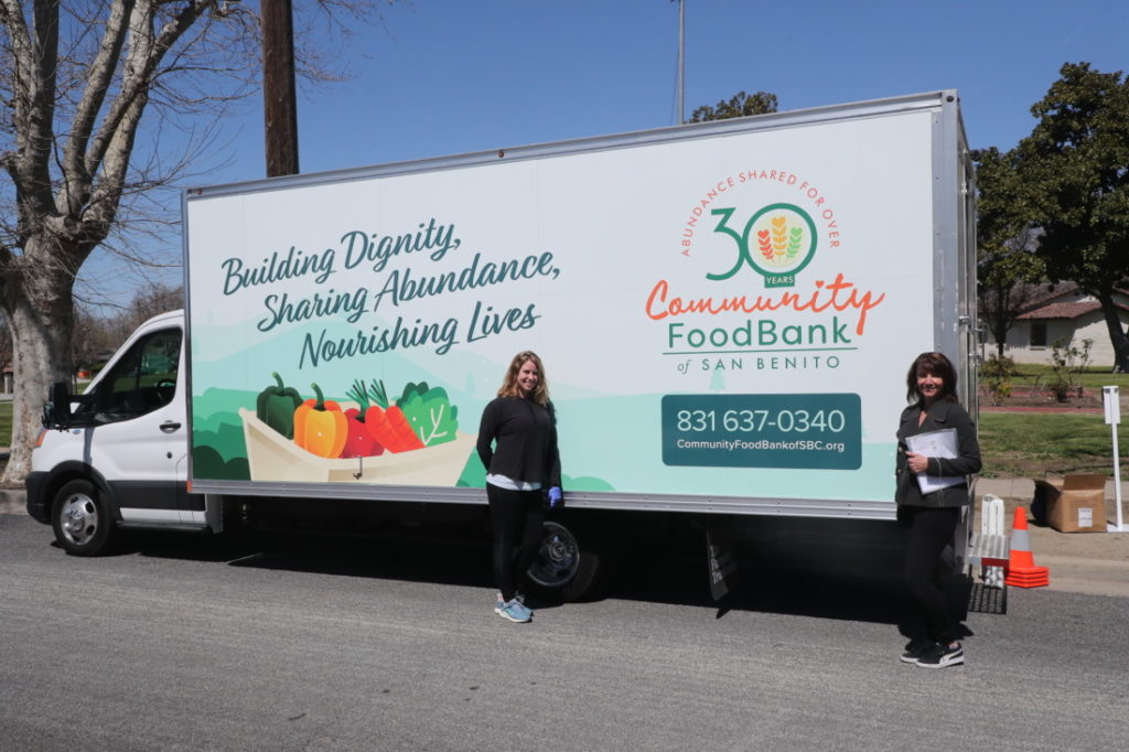 Sarah Nordwick (left) and Nancy Frusetta (right) stand with the Mobile Pantry. Photo courtesy of Sarah Nordwick.