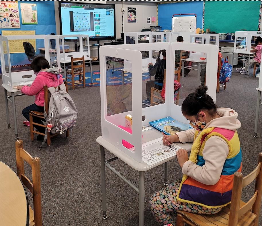 Elementary-school students study back at San Juan School. Photo by courtesy of Elizabeth Cord.