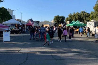 People walk around the Farmer's Market. Photo courtesy of Felicia Bisceglia, Farmers' Market manager.