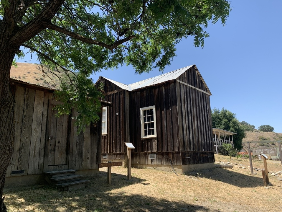 Tres Pinos Jail and Woods cabin. Photo by Robert Eliason.