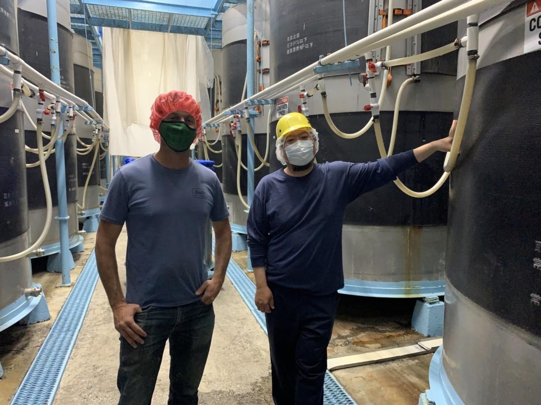 Cory Waller and Seiichi Matsuda by fermenting tanks. Photo by Robert Eliason.