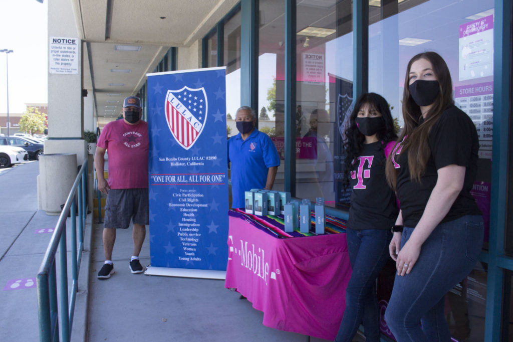 LULAC members Richard Perez (back left) and Vince Luna (back right) with T-mobile expert Angela Jacobo (front left) and sales and operations manager Alyssa Sims (front right). Photo by Noe Magaña.