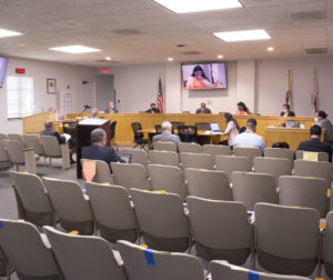 Board of Supervisors discussing items in the May 11 agenda in front of mostly empty room other than staff and a public member. Photo by Noe Magaña.