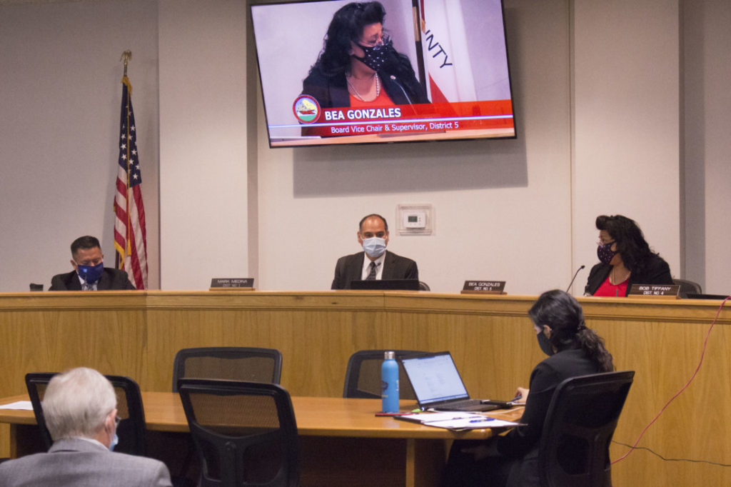 Supervisor Mark Medina (middle) announced at the May 25 meeting he was resigning. Photo by Noe Magaña.