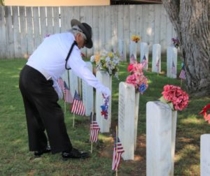 Wreaths and flowers were placed at headstones of veterans buried in Calvary Cemetery. Photo by John Chadwell.