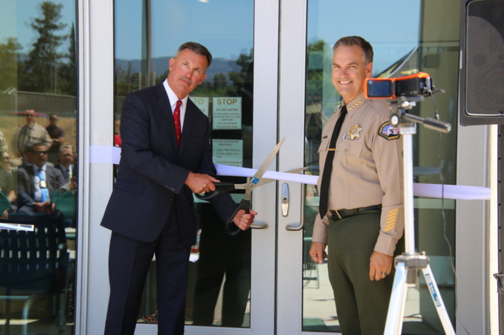 Retired Sheriff Curtis J. Hill (left), who the facility is named after, and outgoing Sheriff Darren Thompson, cut the ribbon to open the building. Photo by John Chadwell.