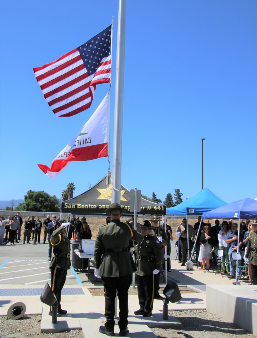 Sheriff's Honor Guard raises flags in front of the new facility. Photo by John Chadwell.