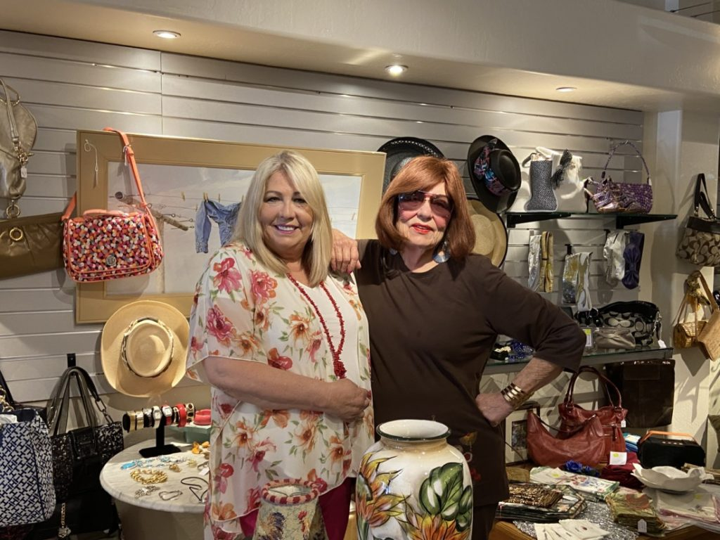 Employee, Susan Tiffan (left), and owner, Sheila Stevens in She's Consignment Store. Photo by Jenny Mendolla Arbizu.