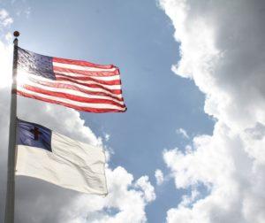 The Christian flag flies under the U.S. flag. Pixabay photo.