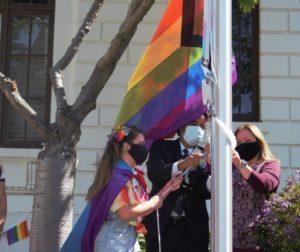 Aislinn Barnes (left), Hollister Mayor Ignacio Velazquez and City Clerk Christine Black placing the flag on the pole in front of City Hall during the 2021 event. Photo by Noe Magaña.
