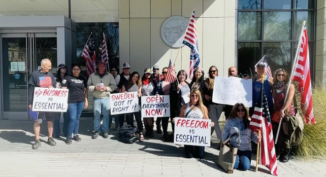 Courtney Evans and a group of supporters outside of the Superior Court of San Benito County on March 30, 2021. Photo courtesy of Courtney Evans.