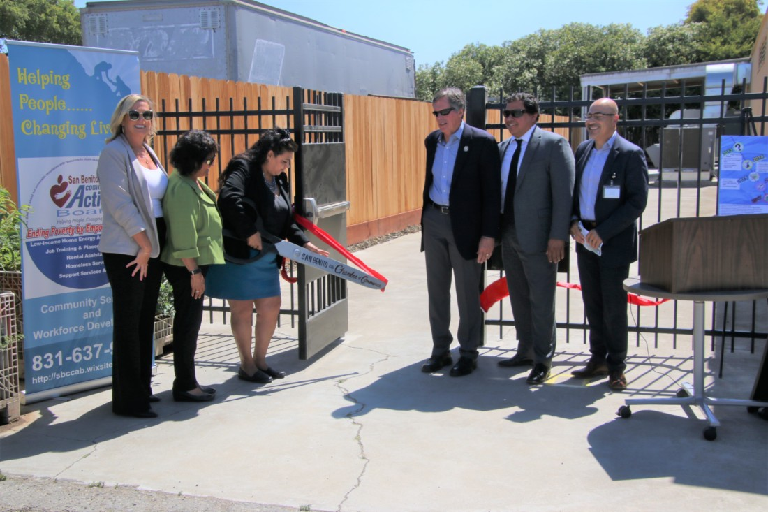 Supervisor Bea Gonzales on July 8 cuts the ribbon for the new transition units, part of a program that aims to help individuals find jobs and eventually move to permanent housing. Photo by John Chadwell.