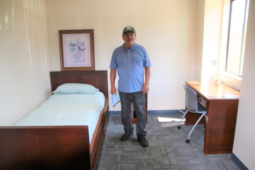 Last January, Larry Avira was using drugs and alcohol, and was homeless living near the railroad tracks on the north side of Hollister. On July 8 he was sober, and one of the first to inhabit one of the six transition units just opened. He hopes to apply for a job at the new Amazon facility being built just down the street. Photo by John Chadwell.