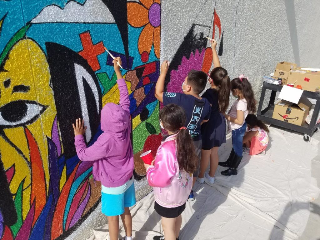 Students working on HDLA's mural. Photo courtesy of SBC Arts Council.