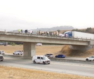 Protest over the Y road and Betabel Road overpass. Photo by Noe Magaña.