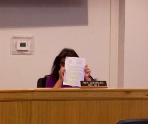 Supervisor Bea Gonzales shows the public her notes on her copy of the policy to test unvaccinated county employees. Photo by Noe Magaña.
