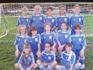 Suzy Brookshire (middle row, right) in the Hollister Roadrunners team photo. 2006 class 1 Abrozino League Champions. Photo courtesy of Ted Vandenberg.