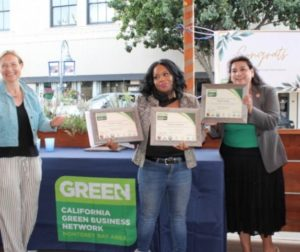 Heliena Walton receives three certificates presented by San Benito County Supervisor Bea Gonzales and Hollister City Council member Rick Perez. Seen here with Gonzales and Brooke Wright of Monterey Green Business Program. Photo Carmel de Bertaut.