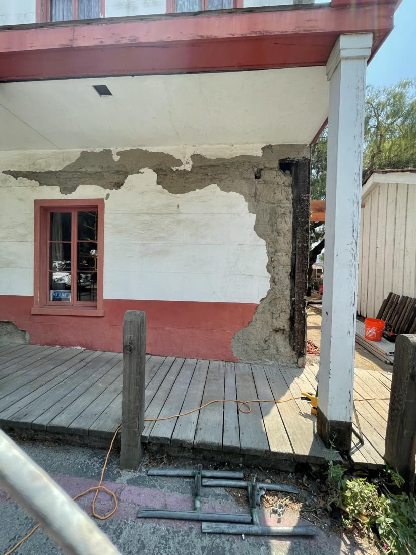 Damage to the adobe. Photo by Robert Eliason.