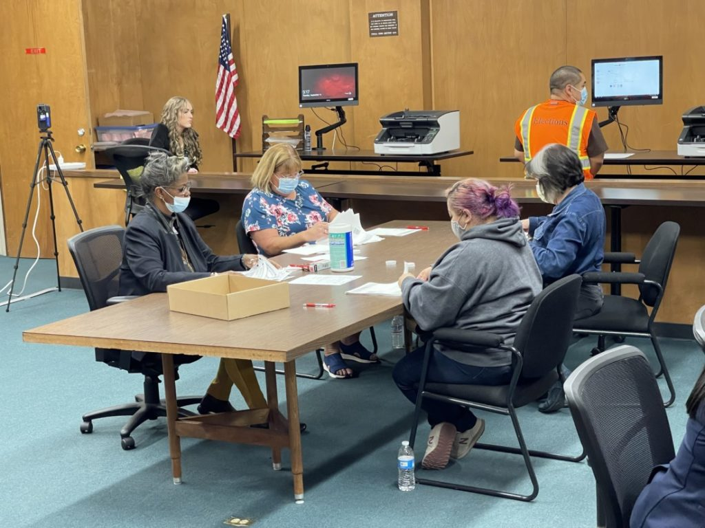 Ballots being checked for errors. Photo by Robert Eliason.
