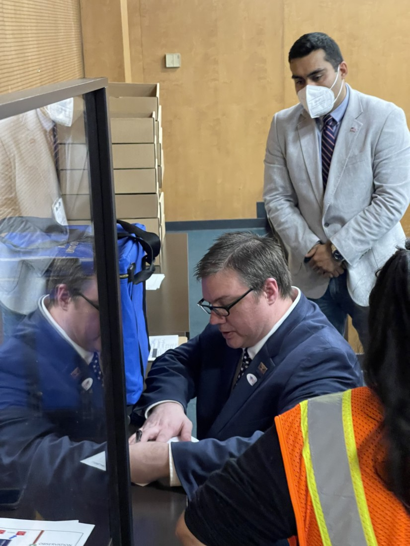 David Quick and Francisco Diaz Lopez verifying delivery. Photo by Robert Eliason.