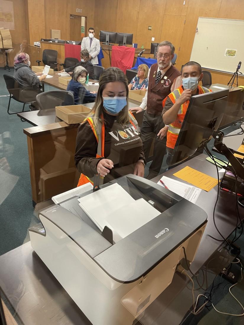 Ballots being counted. Photo by Robert Eliason.