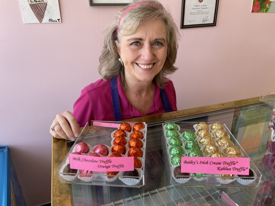 Margot Tankersley and her candy. Photo by Robert Eliason.
