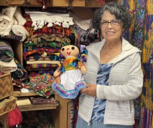 Connie Lopez and Lele doll. Photo by Robert Eliason.