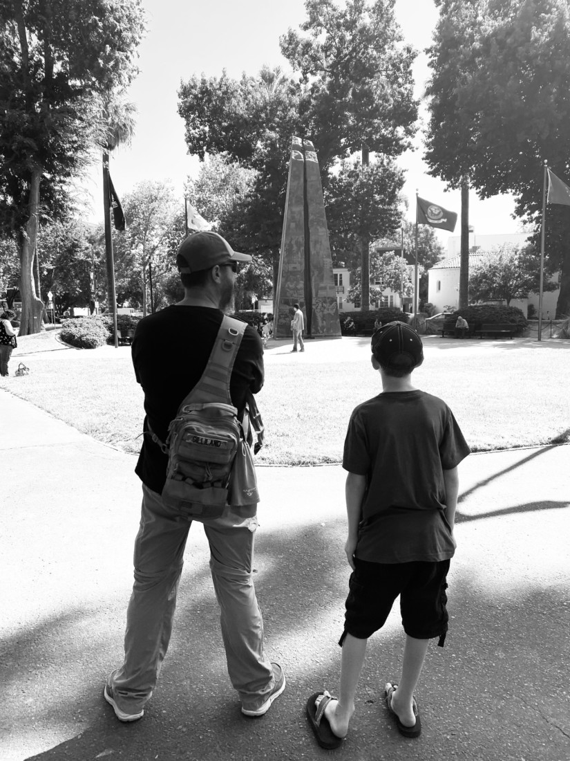 Chase and his father looking at the Veterans Memorial. Photo courtesy of Jessica Gililland.