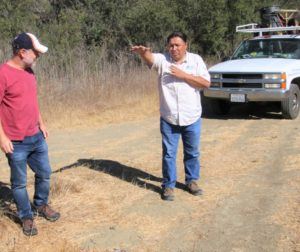 Henry Garcia shows Henry Rhunke where the proposed River Walk Trail will circle the Betabel property. Photo by John Chadwell.