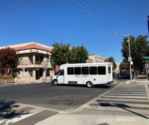 A County Express bus crossing San Benito Street. Photo by Noe Magaña.